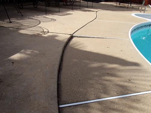 Sinking concrete pool deck