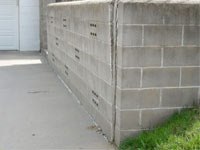 A retaining wall separating from the adjoining walls in Edgerton