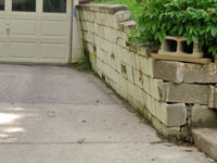 a failing retaining wall around a driveway in Cheyenne