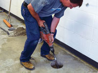 Coring the concrete of a concrete slab floor in Lander