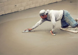 smoothing out the grout in a slab releveling project in Green River