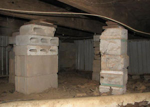 crawl space repairs done with concrete cinder blocks and wood shims in a Worland home