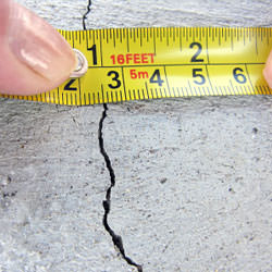 A crack in a poured concrete wall that's showing a normal crack during curing in Clearmont