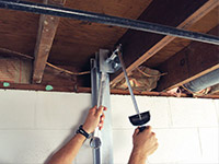 Straightening a foundation wall with the PowerBrace™ i-beam system in a Jackson home.