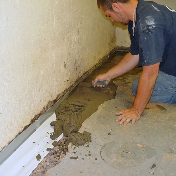 Testing a French drain system in a Evnasville home. Sump Pump Installation in Wyoming   Installing a Sump Pump System