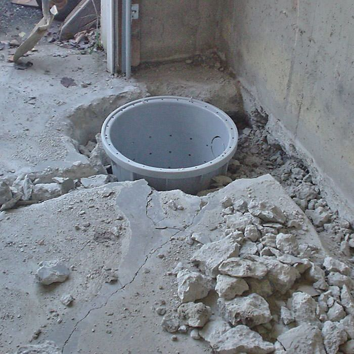 Placing a sump pit in a Mills home. Sump Pump Installation in Wyoming   Installing a Sump Pump System