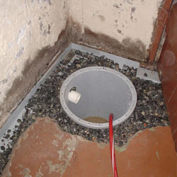 Installing a sump in a sump pump liner in a Gillette home