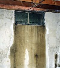 Flooding through basement windows in a Clearmont home.