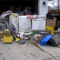 Soaked, wet personal items sitting in a driveway, including a washer and dryer in Green River.