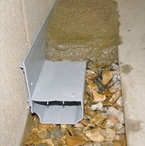 french drain or drain tile installed along the inside perimeter of the foundation for waterproofing