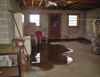 a flooded basement floor in a Clearmont home